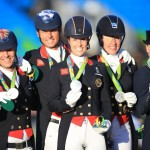 (L-R) Great Britain's Spencer Wilton, Carl Hester, Charlotte Dujardin and Fiona Bigwood celebrate with their silver medals following the Dressage Team Grand Prix at the Olympic Equestrian Centre on the seventh day of the Rio Olympic Games, Brazil.